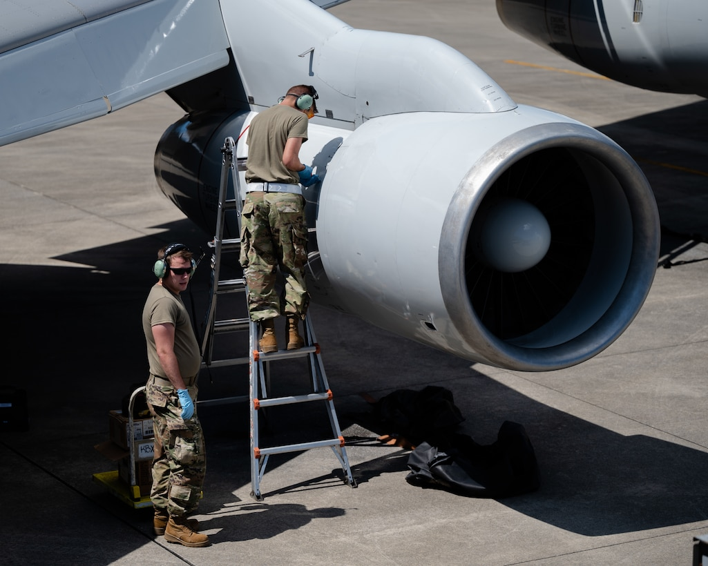 U.S. Air Force Airman 1st Class Andrew Foust, left, 961st Aircraft Maintenance Unit aerospace propulsion apprentice, and Airman 1st Class Trevor Fisher, right, 961st AMU aerospace propulsion apprentice, inspect an E-3 Sentry engine at Kadena Air Base, Japan, Aug. 30, 2021. The 961st AMU are responsible for ensuring E-3 Sentries are capable of protecting U.S. and coalition force interests in the INDO-Pacific region. (U.S. Air Force photo by Airman 1st Class Stephen Pulter)