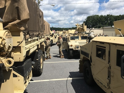 A massive convoy of Georgia National Guard personnel and equipment prepares to depart the armory of the 170th Military Police Battalion, 201st Regional Support Group, in Decatur, Georgia, Sept. 1, 2021. Convoys from across the state are moving relief supplies and heavy equipment along with Citizen-Soldiers and -Airmen who have honed their expertise at debris removal, transportation and logistics support, security and traffic control during responses to Hurricanes Irma, Michael and Dorian.