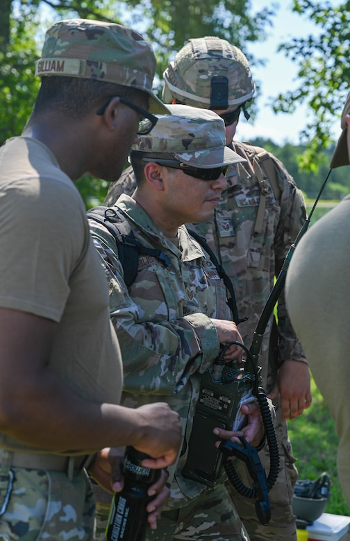 U.S. Air Force Airmen from the 633d Civil Engineer Squadron, operate a radio during joint tactical convoy operations training at Joint Base Langley-Eustis, Virginia, August 19, 2021. Army Soldiers assigned to the 149th Seaport Operations Company, 7th Transportation Brigade, instructed Airmen on the different aspects of convoy procedures and safety. (U.S. Air Force photo by Senior Airman Sarah Dowe)