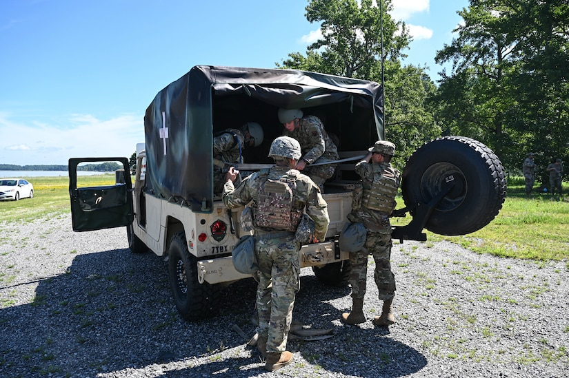 U.S. Air Force Airmen from the 633d Civil Engineer Squadron, climb into a Humvee during joint tactical convoy operations training at Joint Base Langley-Eustis, Virginia, August 19, 2021. Army Soldiers assigned to the 149th Seaport Operations Company, 7th Transportation Brigade, prepared the training and guided the Airmen through it. (U.S. Air Force photo by Senior Airman Sarah Dowe)