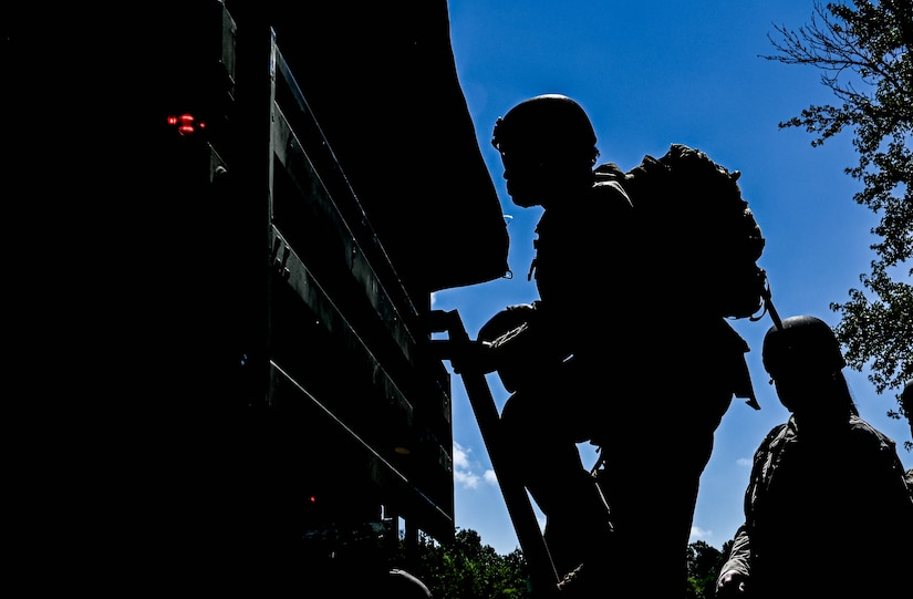 U.S. Air Force Airmen from the 633d Civil Engineer Squadron, climb into a truck during joint tactical convoy operations training at Joint Base Langley-Eustis, Virginia, August 19, 2021. Army Soldiers assigned to the 149th Seaport Operations Company, 7th Transportation Brigade, directed and guided the Airmen through the training. (U.S. Air Force photo by Senior Airman Sarah Dowe)