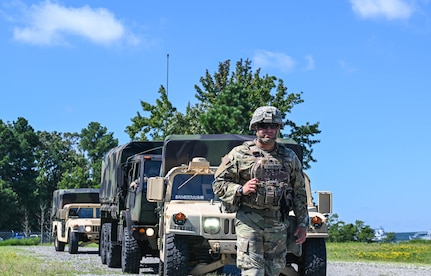U.S. Army Soldiers assigned to the 149th Seaport Operations Company, 7th Transportation Brigade, leads a convoy during joint tactical convoy operations training at Joint Base Langley-Eustis, Virginia, August 19, 2021. The training taught communication procedures for improvised explosive devices and unexploded ordinance scenarios, how to fill out medevac reports and how to properly operate a radio. (U.S. Air Force photo by Senior Airman Sarah Dowe)