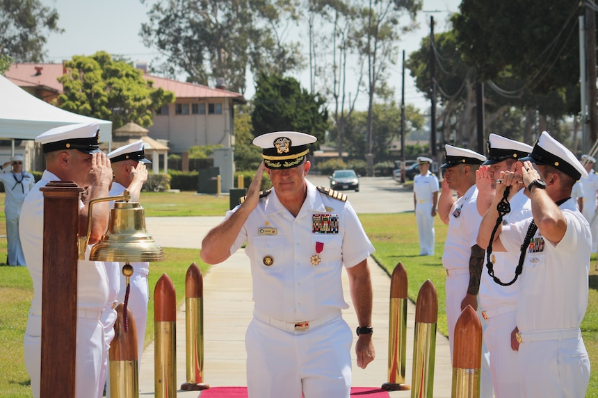 PORT HUENEME, Calif. (Aug. 26, 2021) Capt. Christopher Kurgan pipes ashore, relieved as commanding officer of the Center for Seabees and Facilities Engineering (CSFE) during a change of command ceremony Aug. 26. CSFE trains civil engineering corps officers, enlisted Seabees and environmental professionals. (U.S. Navy photo by Amber Vaglica)