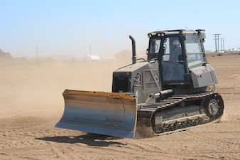"""PORT HUENEME, Calif. (Aug. 26, 2021) Force Master Chief Matthew Harris trains to drive the D5 dozer at the equipment operator schoolhouse """"Dozer Field"""" at Naval Construction Training Center (NCTC)  Port Hueneme.  NCTC Port Hueneme is one of five learning sites in the Center for Seabees and Facilities Engineering domain.  They train and develop Sailors, Soldiers, Airmen, and Marines in construction trades to accomplish contingency and peacetime construction, chemical, biological, and radiological operations, and humanitarian assistance missions worldwide. (U.S. Navy photo by Amber Vaglica)"""