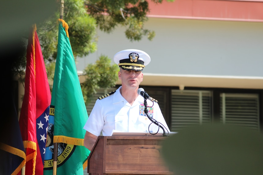 PORT HUENEME, Calif. (Aug. 26, 2021) Capt. Peter Maculan reads his orders during the Center for Seabees and Facilities Engineering (CSFE) change of command Aug. 26, where he relieved Capt. Christopher Kurgan. CSFE trains civil engineering corps officers, enlisted Seabees and environmental professionals. (U.S. Navy photo by Amber Vaglica)