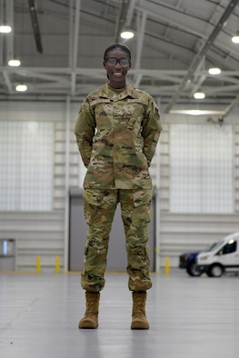 Senior Airman Diass Seck poses for a photo at Westover Air Reserve Base in Massachusetts.