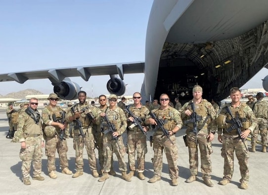 Department of Defense personnel, including Airmen from the 80th Aerial Port Squadron, Dobbins Air Reserve Base, Georgia, conclude support to operations in Afghanistan, August 2021.