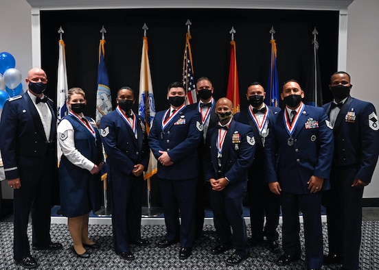 Inductees and leadership pose for a photo at the Senior Noncommissioned Officer Induction Ceremony.