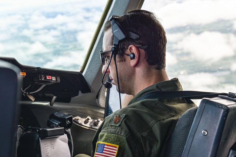 U.S. Air Force Maj. Thomas C. deCiutiis, 305th Operations Support Squadron deputy chief of the Formal Training Unit and instructor pilot, co-pilots a KC-10 Extender and observes training during a flight at Joint Base McGuire-Dix-Lakehurst, N.J., July 8, 2021. It is the instructor's responsibility to both guide the student and maintain the safety of the aircraft and its crew during an in-flight training.