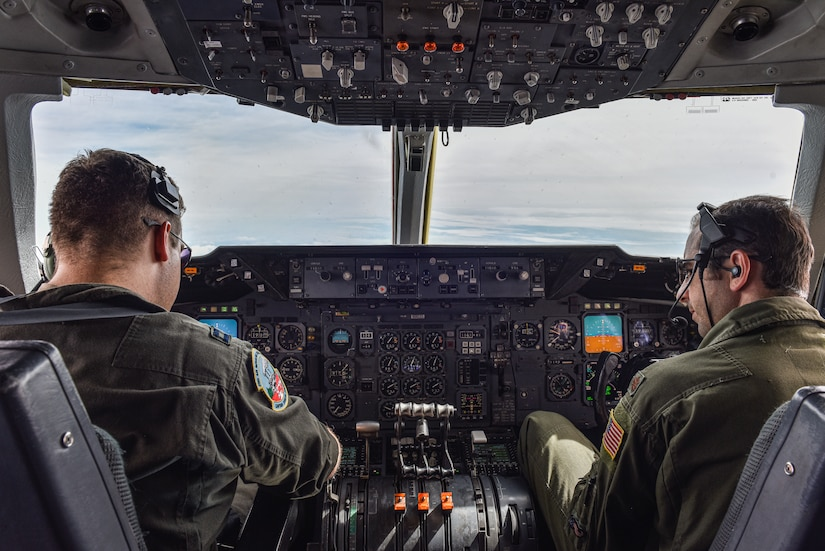 U.S. Air Force Capt. David Crowley, 78th Air Refueling Squadron pilot and 305th Operations Support Squadron Formal Training Unit student, left, and U.S. Air Force Maj. Thomas C. deCiutiis, 305th OSS deputy chief of the Formal Training Unit and instructor pilot, right, coordinate with KC-135 aircrew before in-flight refuel training at Joint Base McGuire-Dix-Lakehurst, N.J., July 8, 2021. The KC-135 Stratotanker aircrew is assigned to the 101st Air Refueling Wing from Bangor Air National Guard Base, Maine. (U.S. Air Force Photo by Staff Sgt. Shay Stuart)