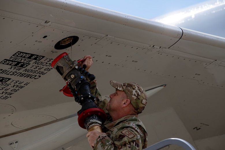 An Airman from the Kentucky Air National Guard's 123rd Contingency Response Group refuels a plane after it brought Afghan evacuees to Volk Field, Wis., Aug. 29, 2021. The Department of Defense, in support of the Department of Homeland Security and the Department of State, is providing transportation and temporary housing for evacuees as part of Operation Allies Refuge. The initiative follows through on America's commitment to Afghan personnel who have helped the United States, and provides them essential support at secure locations outside Afghanistan. (U.S. Army photo by Spc. Rhianna Ballenger, 55th Signal Company)