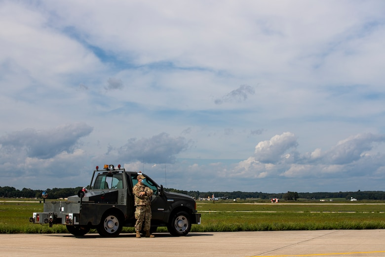 An Airman from the Kentucky Air National Guard's 123rd Contingency Response Group prepares to receive an aircraft carrying Afghan evacuees at Volk Field, Wis., Aug. 29, 2021. The Department of Defense, in support of the Department of Homeland Security and the Department of State, is providing transportation and temporary housing for evacuees as part of Operation Allies Refuge. The initiative follows through on America's commitment to Afghan personnel who have helped the United States, and provides them essential support at secure locations outside Afghanistan. (U.S. Army photo by Spc. Rhianna Ballenger, 55th Signal Company)