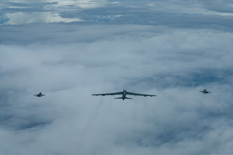 A U.S. Air Force B-52 Stratofortress assigned to the 2nd Bomb Wing, Barksdale Air Force Base, Louisiana, flies next to two Indonesian Air Force F-16s during a Bomber Task Force (BTF) deployment in the Indo-Pacific region, Sept. 1, 2021. This is the first time a B-52 has integrated with the Indonesian Air Force during flight. BTF missions demonstrate the credibility of our forces to address a diverse and uncertain security environment. (U.S. Air Force photo by Tech. Sgt. Matthew Lotz)