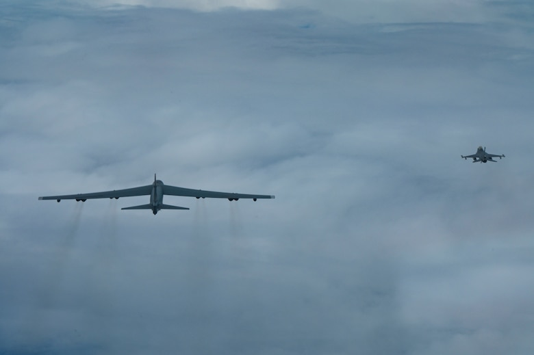 A U.S. Air Force B-52 Stratofortress assigned to the 2nd Bomb Wing, Barksdale Air Force Base, Louisiana, flies next to an Indonesian Air Force F-16 during a Bomber Task Force deployment in the Indo-Pacific region, Sept. 1, 2021. This is the first time a B-52 has integrated with the Indonesian Air Force during flight. The B-52 is a long range bomber with a range of approximately 8,800 miles, enabling rapid support of Bomber Task Force missions or deployments and reinforcing global security and stability. (U.S. Air Force photo by Tech. Sgt. Matthew Lotz)
