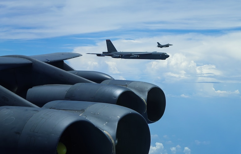 A U.S. Air Force B-52 Stratofortress assigned to the 2nd Bomb Wing, Barksdale Air Force Base, Louisiana, flies next to an Indonesian Air Force F-16 during a Bomber Task Force (BTF) deployment in the Indo-Pacific region, Sept. 1, 2021. This is the first time a B-52 has integrated with the Indonesian Air Force during flight. BTF missions demonstrate the credibility of our forces to address a diverse and uncertain security environment. (U.S. Air Force photo by Tech. Sgt. Matthew Lotz)