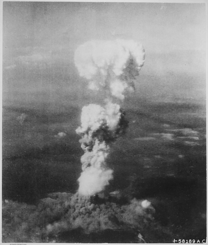 The atomic bomb, dropped by the crew of the 509th Composite Group's B-29 Superfortress Enola Gay, detonates over Hiroshima, Japan. The first of two historic drops, these missions contributed to forcing Japan to surrender, ending World War II. (U.S. Army Air Forces file photo)