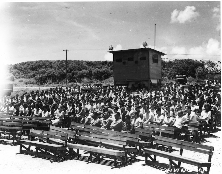 Members of the 509th Composite Group gather for a chaplain-led service on Tinian, 1945, following the surrender of the Japanese Empire. (U.S. Army Air Forces file photo)