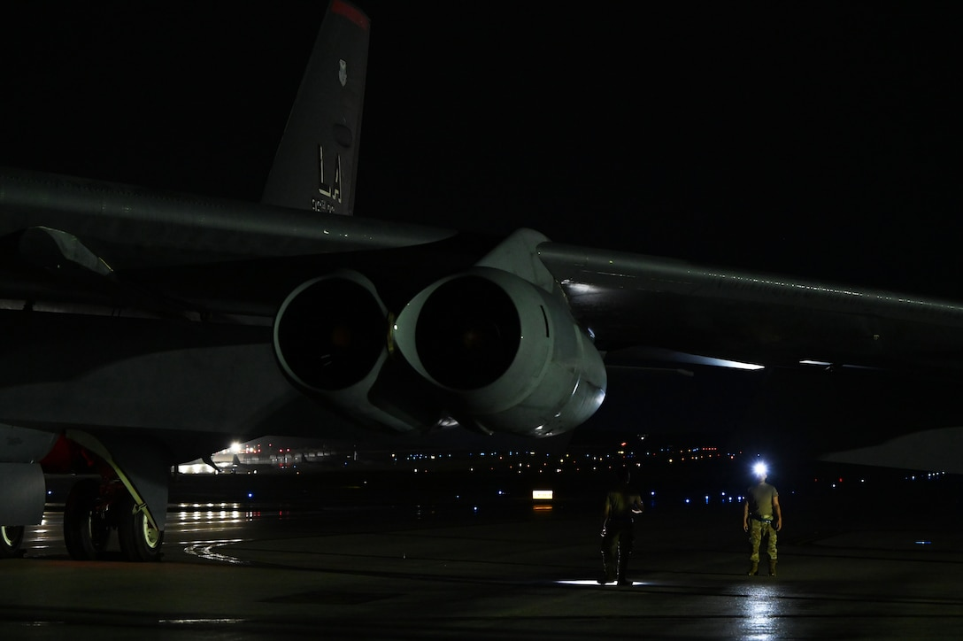 U.S. Air Force Airmen from the 20th Aircraft Maintenance Unit, Barksdale Air Force Base, Louisiana, inspect a B-52 Stratofortress upon arrival at Andersen Air Force Base, Guam, Aug. 26, 2021. This deployment allows aircrews and support personnel to conduct theater integration and to improve bomber interoperability with allies and partners. (U.S. Air Force photo by Staff Sgt. Alysia Blake)