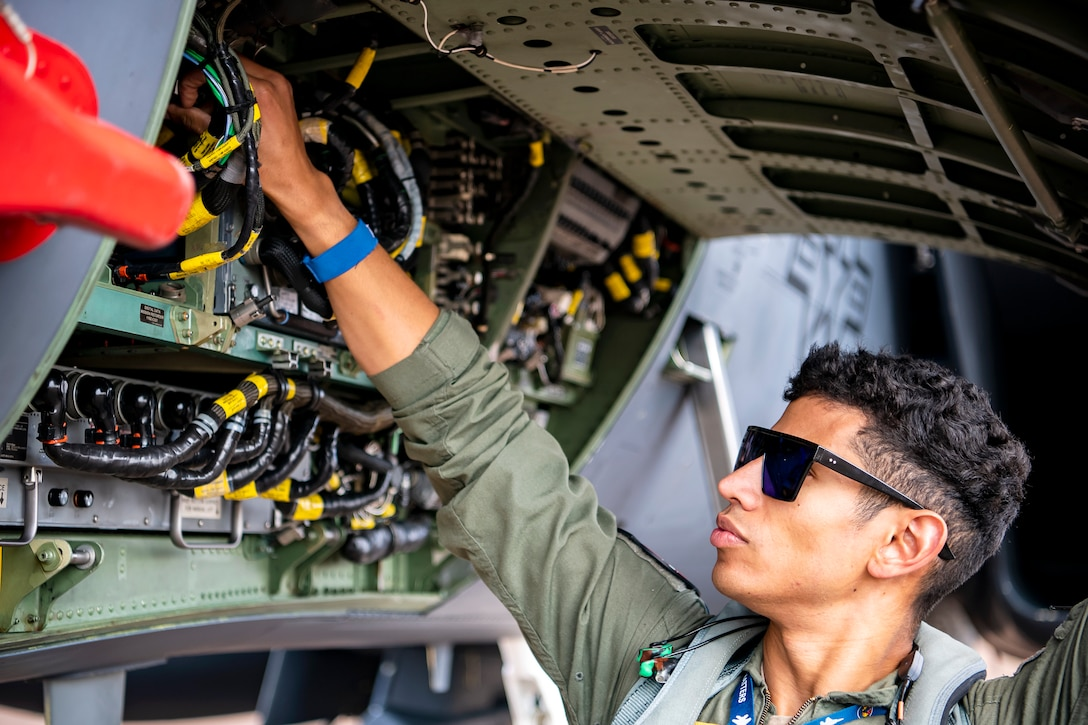 U.S. Air Force 1st Lt. Kyle Gager, 492d Fighter Squadron weapons systems officer, inspects the internal components of an F-15E Strike Eagle during an Agile Combat Employment exercise at RAF Fairford, England, Aug. 23, 2021. Utilizing ACE concepts ensures that U.S. forces in Europe are better equipped to operate from locations with varying levels of capacity and support to accomplish the mission. (U.S. Air Force photo by Senior Airman Eugene Oliver)