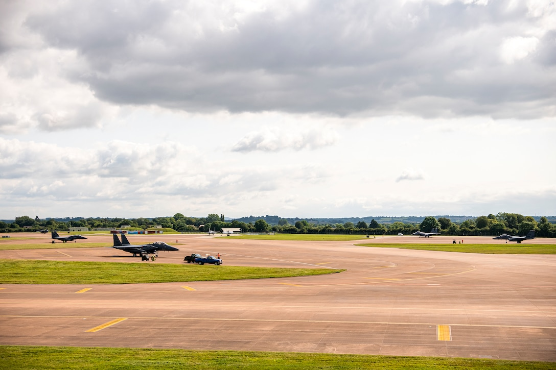 Six F-15E Strike Eagles assigned to the 492d Fighter Squadron, static during an Agile Combat Employment exercise at RAF Fairford, England, Aug 23, 2021. The exercise enables U.S. forces in Europe to operate from locations with varying levels of capacity and support. This further ensures Airmen and aircrews are postured to deliver lethal combat power across the full spectrum of military operations. (U.S. Air Force photo by Senior Airman Eugene Oliver)