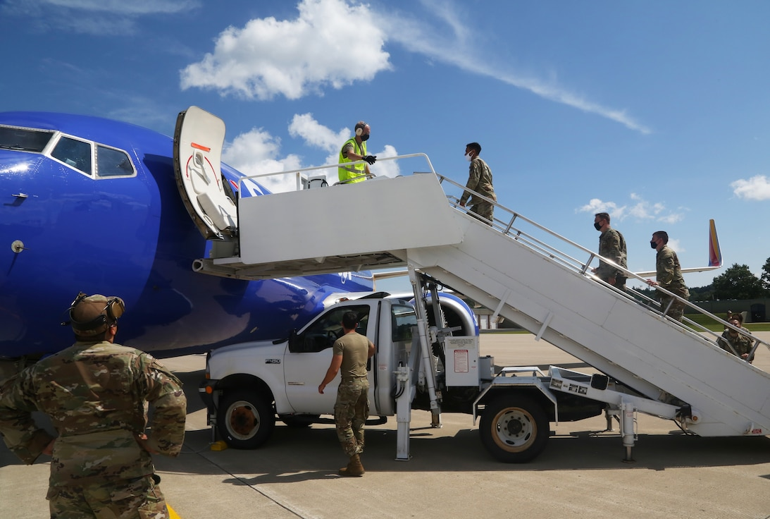 U.S. Soldiers assigned to the 271st Movement Control Team and Airmen from the Kentucky Air National Guard's 123rd Contingency Response Group receive a plane of Afghan evacuees at Volk Field, Wis., Aug. 29, 2021. The Department of Defense, through U.S. Northern Command, and in support of the Department of State and Department of Homeland Security, is providing transportation, temporary housing, medical screening and general support for up to 50,000 Afghan evacuees at suitable facilities, in permanent or temporary structures, as quickly as possible. This initiative provides Afghan personnel essential support at secure locations outside Afghanistan. (U.S. Army photo by Spc. Eric Cerami/ 55th Signal Company)