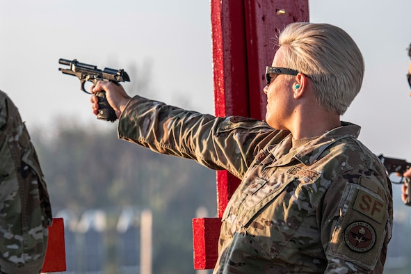Female NCO fires weapon