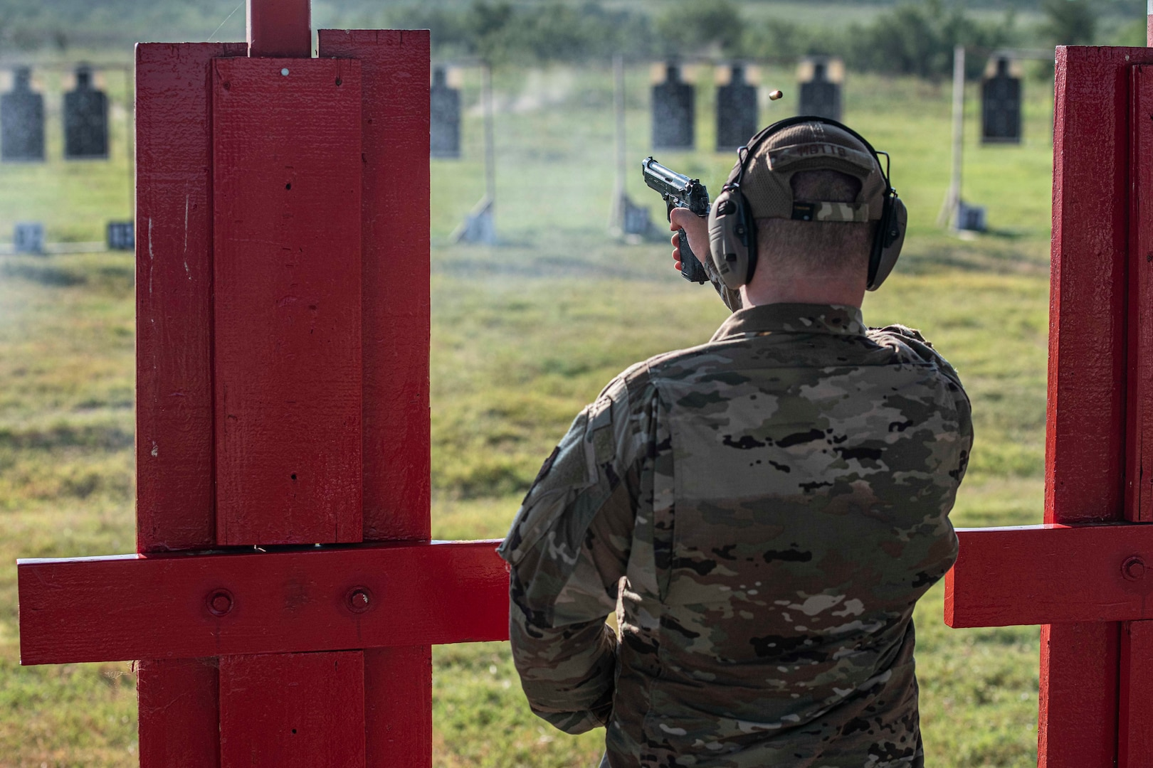 Shooter fires with a Beretta M9