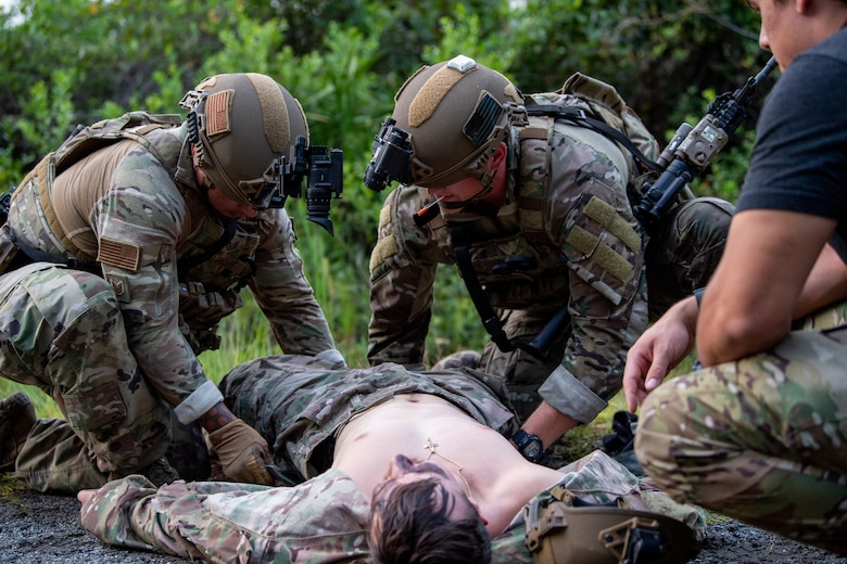 Photo of Airmen conducting medical training on another Airman laying on the ground