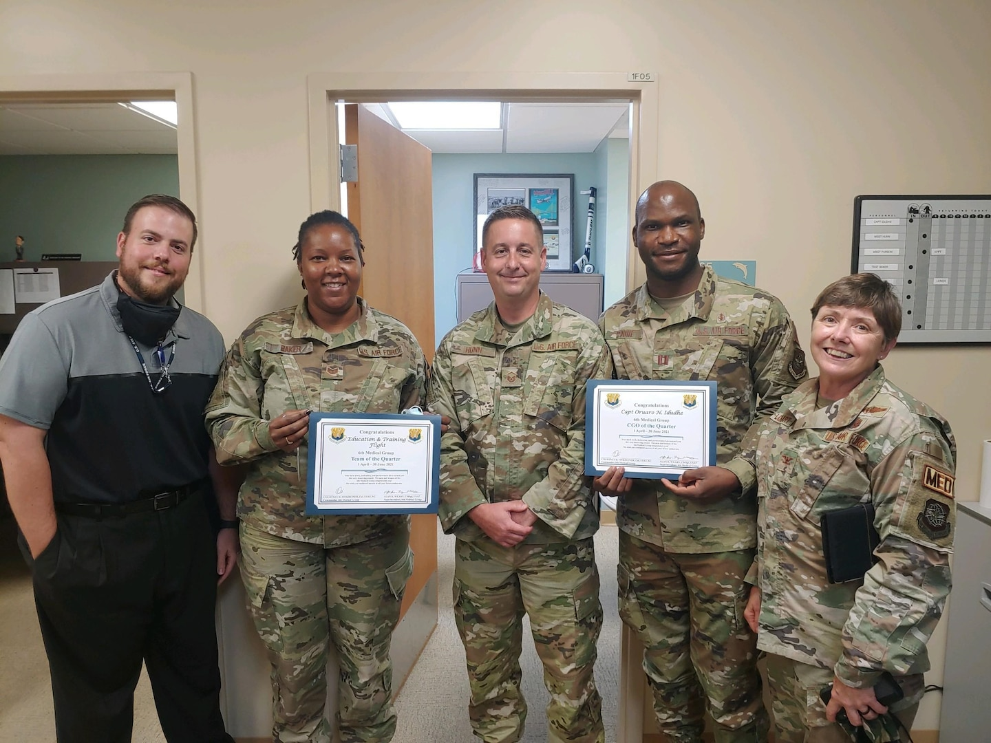 Personnel assigned to the 6th Medical Group's Education and Training Flight, MacDill Air Force Base, Florida, pose for a group photo Aug. 3, 2021. The Education and Training Flight was presented the 6th MDG's 'Team of the Quarter' for April 1 – June 30, 2021. The team pioneered a Department of Defense transition from self-aid buddy care to tactical combat casualty care and certified 12 instructors across the command. From left, Dustin Sieff, Tech Sgt. Kierra Baker, Master Sgt. Matthew Hunn, Capt. Oruaro Idudhe and Col. Cheryl Lockhart (Not pictured: James Norbech and Richard Cook). (Courtesy photo)