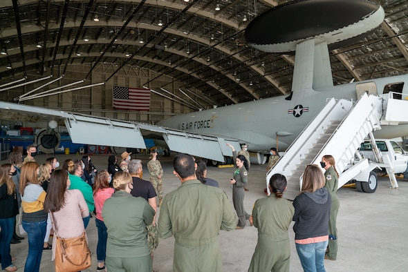 Spouses from the 3rd Wing receive a briefing on the E-3 Sentry Airborne Warning and Control System during an immersion tour at Joint Base Elmendorf-Richardson, Alaska.