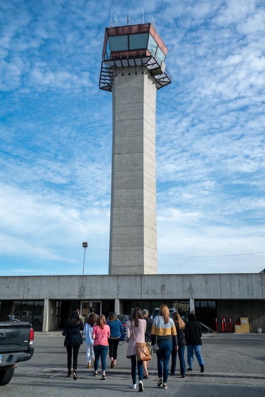 Spouses from the 3rd Wing approach the Air Traffic Control tower during an immersion tour at Joint Base Elmendorf-Richardson, Alaska.
