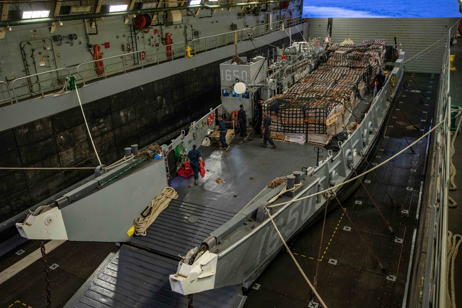 Sailors prepare to launch a landing craft, utility (LCU), assigned to Assault Craft Unit (ACU) 2, from the well deck of USS Arlington (LPD 24) to deliver humanitarian aid to the Port of Jeremie, Haiti, Aug. 31.