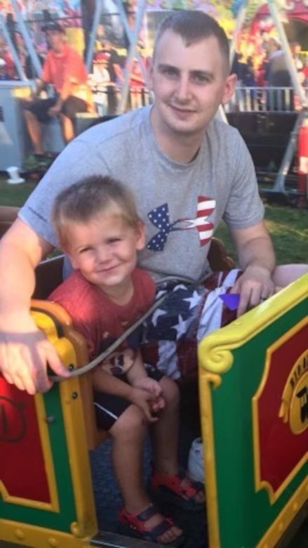 Technical Sgt. Richard Fenton, 9th Operations Support Squadron weather craftsman, and his son pose for a photo at a carnival July 4, 2016 in Mascoutah, Illinois.