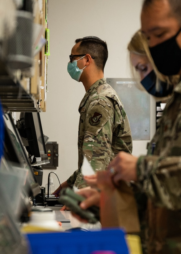 U.S. Air Force Tech. Sgt. Andrew Bañales, 18th Medical Support Squadron NCO in charge of pharmacy, talks with a patient at Kadena Air Base, Japan, Sept. 1, 2021. Medication experts in the Air Force provide patients with counseling on their medications and are held to thorough quality control measures to ensure medication is handed out accurately. (U.S. Air Force photo by Airman 1st Class Stephen Pulter)