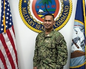 GUAM -- Military Sealift Command Far East selected Petty Officer Perpetuo Quintua, a reservist on extended orders in Guam, as its Junior Sailor of the Quarter.  While assigned to Ship Support Unit Guam as the lead medical representative, Quintua has been instrumental in keeping civil service mariners healthy and vaccinated.  His efforts have helped ensure the medical readiness of the MSC fleet operating in the Indo-Pacific Region. (U.S. Navy Photo by Rey Rabara)