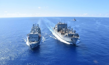 USNS Alan Shepard (T-AKE 3), left, conducts an underway replenishment with RFA Fort Victoria (A 387) while USS The Sullivans (DDG 68) follows in the East China Sea.