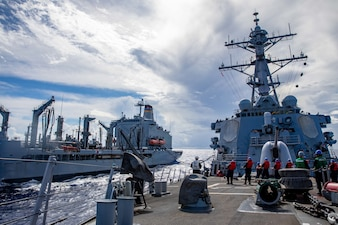 USS Barry (DDG 52) conducts a replenishment-at-sea with USNS Yukon (T-AO 202) during MALABAR 2021.