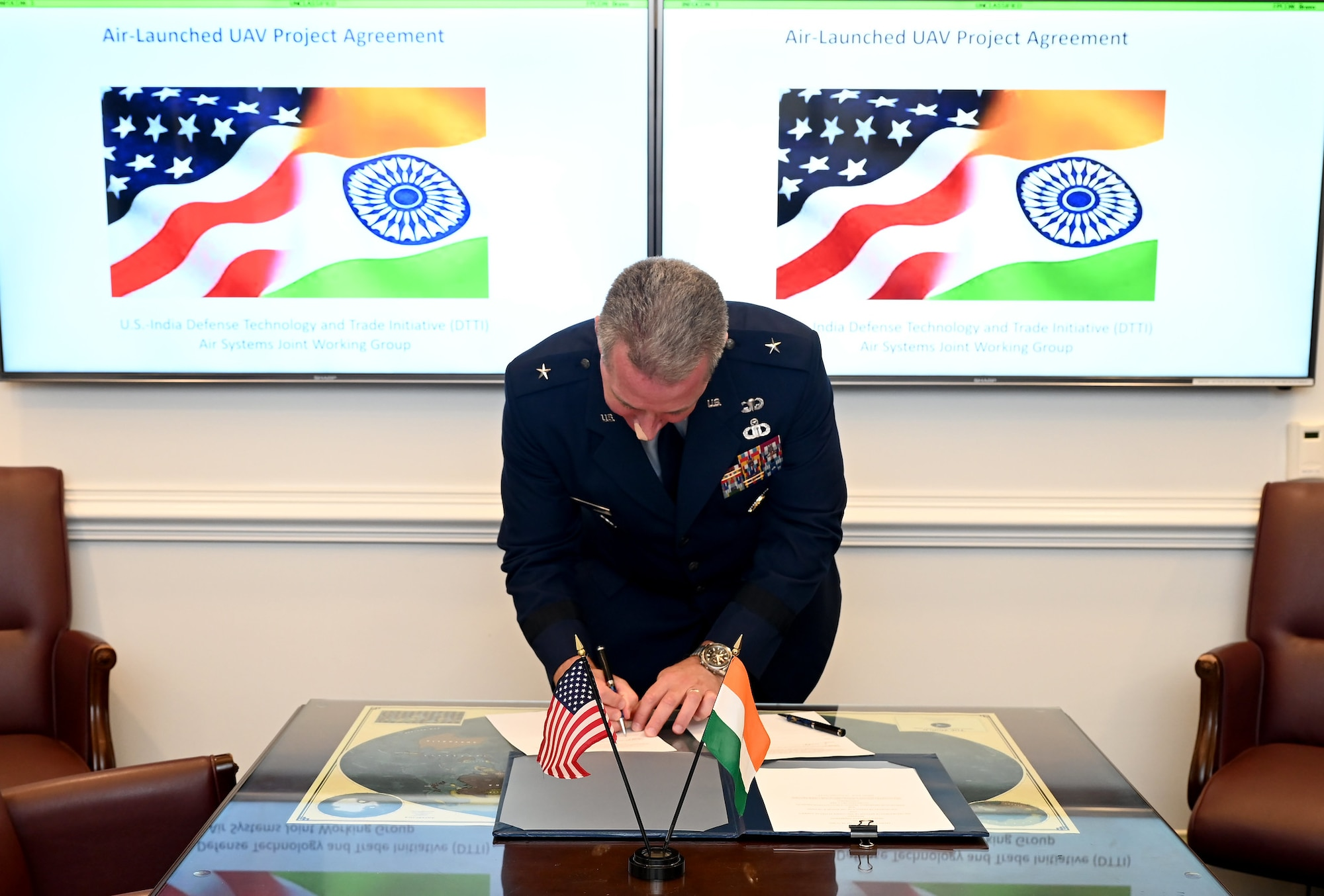 Cochair of the US-India Defense Technology and Trade Initiative, Brig. Gen. Brian Bruckbauer signs the Air Launched UAV Co-Development Agreement at the Pentagon, Arlington, Va., July 16, 2021. (U.S. Air Force photo by Andy Morataya)