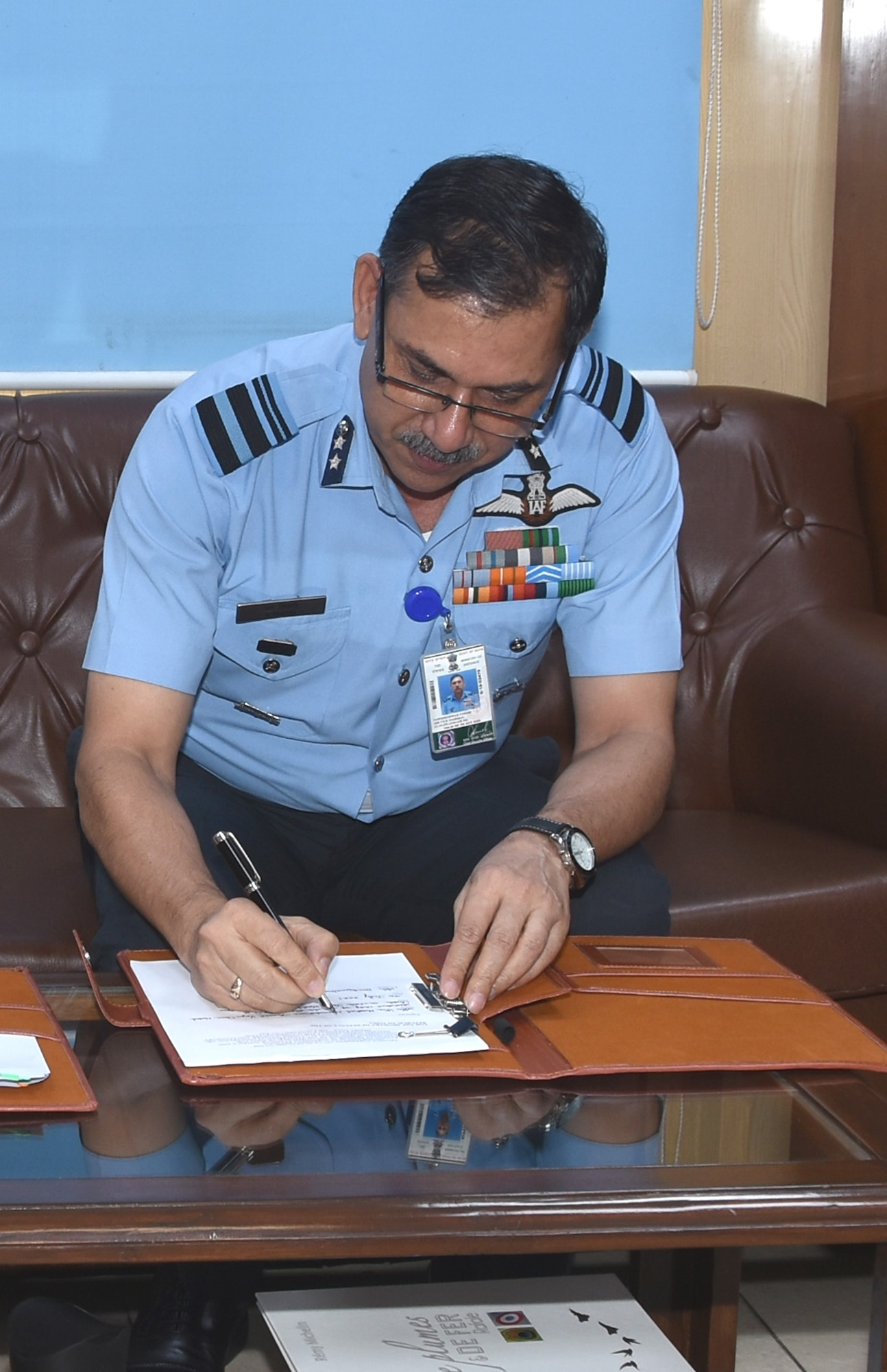 Indian Air Force Air Vice Marshal Narmdeshwar Tiwari, Assistant Chief of Air Staff for Plans, counter-signs a landmark agreement to co-develop air-launched Unmanned Aerial Vehicles under the U.S.-India Defense Technology and Trade Initiative, at Indian Air Force Headquarters in New Delhi, India, on July 30, 2021. (Courtesy photo)
