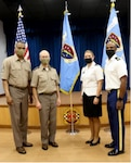 DHA Director, Lieutenant General Ronald J. Place, DHA Senior Enlisted Leader, Command Sgt. Major Michael Gragg, Low Country Market leadership, Col. Julie Freeman, and Command Sgt. Major Charles Robinson stand in front of the new DHA and Low Country Colors, September 2.