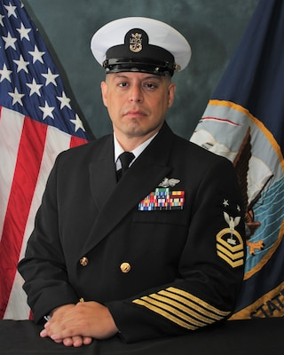 Official portrait of Seabee Master Chief Angel D. Cano