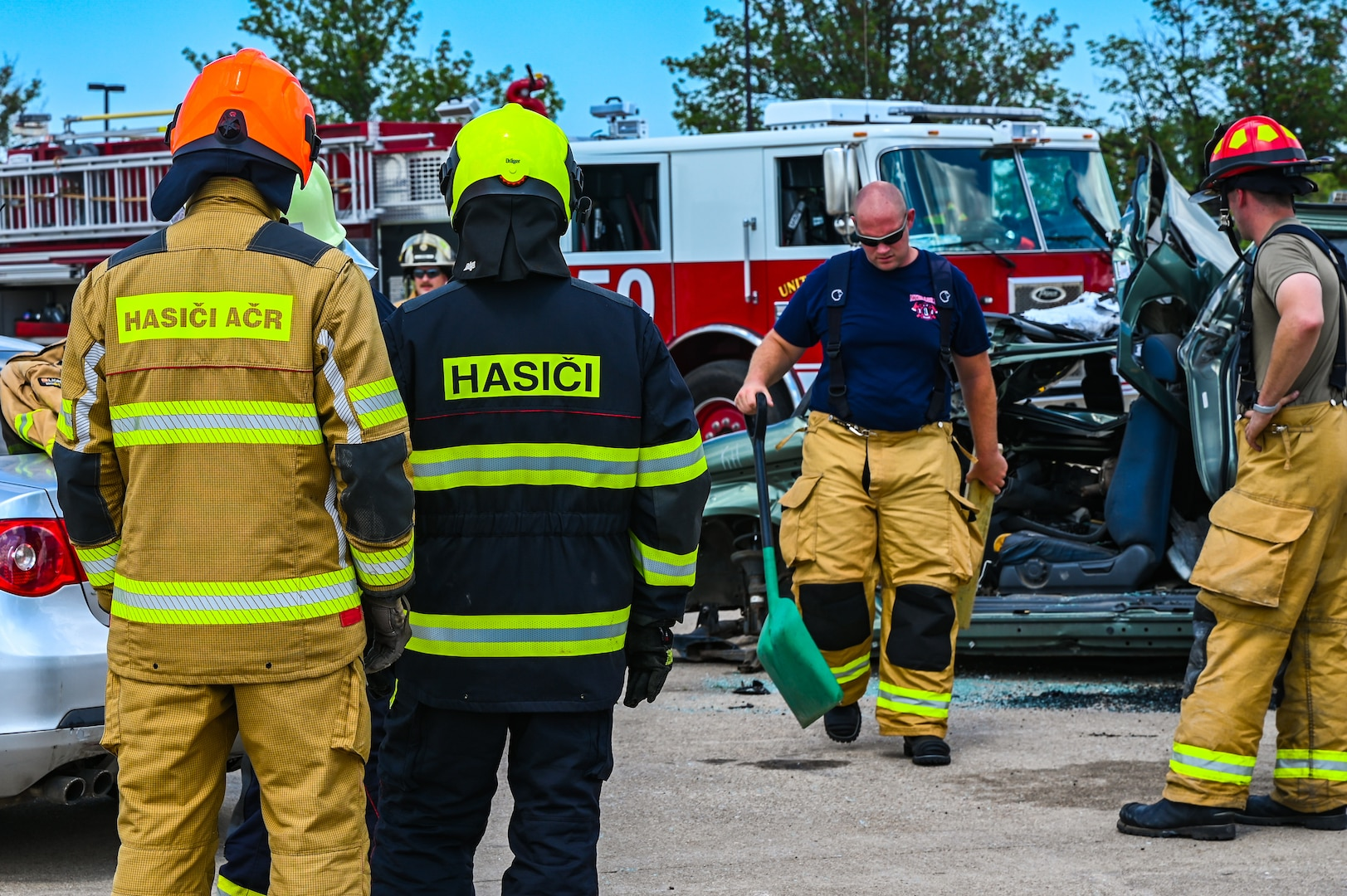 Firefighters from the Army of the Czech Republic perform car extrication tactics, Aug. 16, 2021, during a training exercise with the 155th Air Refueling Wing fire department at Lincoln Air Force Base, Neb. This Nebraska National Guard and Czech Republic armed forces training exchange is one of many facilitated by the National Guard's State Partnership Program.