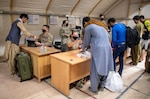 U.S. Army Central Soldiers welcome and assist Afghan evacuees as they arrive and process through locations in Kuwait. DLA Troop Support's Clothing and Textiles supply chain expedited shipping of approximately 5,000 disaster blankets and 90 general purpose tents, which hold up to 10 people each, were delivered to Camp Arifjan September 3, 2021.