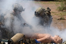 A photo of pararescuemen operating on a simulated injured victim.