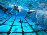U.S. Naval Reserve Officer Training Corps midshipmen with the University of Hawaii at Manoa, swim during an ROTC swimming exercise aboard Marine Corps Base Hawaii, Aug. 15, 2021. This training event was part of the New Student Orientation which serves to standardize midshipmen across the board, providing a baseline level of knowledge on military bearing, presentation, customs, courtesies, and leadership. UH Manoa NROTC staff partnered with MCBH to train aboard the installation and prepare the midshipmen for future careers in the naval service as commissioned officers. (U.S. Marine Corps photo by Lance Cpl. Samantha Sanchez)
