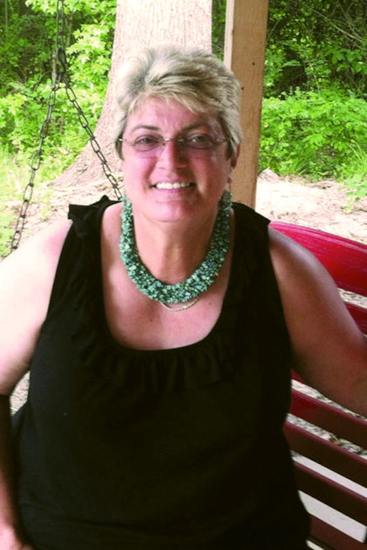 A woman smiles at the camera.