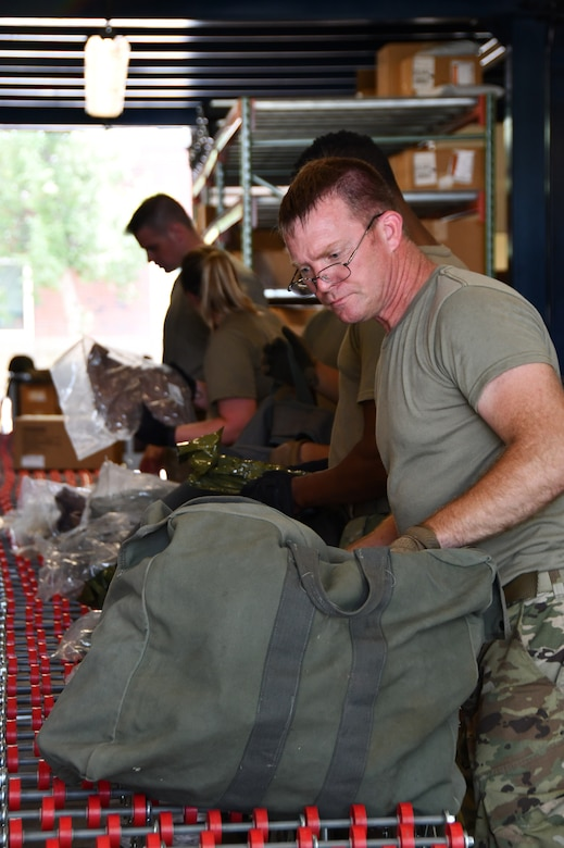 Master Sgt. Matthew Borges, a materials handaler with the 102nd Intelligence Wing, packs a mobility bag during a mobility exercise August 13, 2021, at Barnes Air National Guard Base, Massachusetts. August 13, 2021, at Barnes Air National Guard Base, Massachusetts. Mobility exercises test the wing's ability to rapidly deploy aircraft, equipment, personnel and cargo. (U.S. Air National Guard photo by Staff Sgt. Hanna Smith)