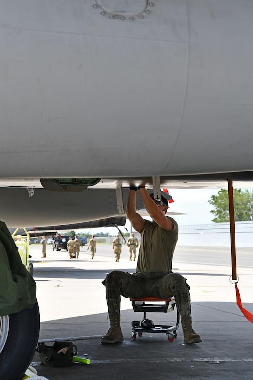 Airman 1st Class Brenden Gadry, a crew chief with the 104th Aircraft Maintenance Squadron, assesses a component of a F-15 Eagle aircraft during a mobility exercise August 15, 2021, at Barnes Air National Guard Base, Massachusetts. Mobility exercises test the wing's ability to rapidly deploy aircraft, equipment, personnel and cargo. (U.S. Air National Guard photo by Staff Sgt. Hanna Smith)