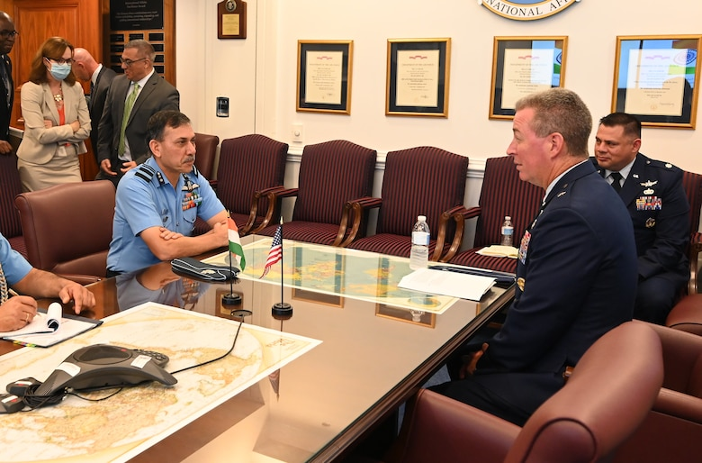 Brig. Gen. Brian Bruckbauer hosts an office call in honor of his fellow cochair of the US-India Defense Technology and Trade Initiative Air Vice Marshal Narmdeshwar Tiwari in the Pentagon, Arlington, Va., July 16, 2021. (U.S Air Force photo by Andy Morataya)