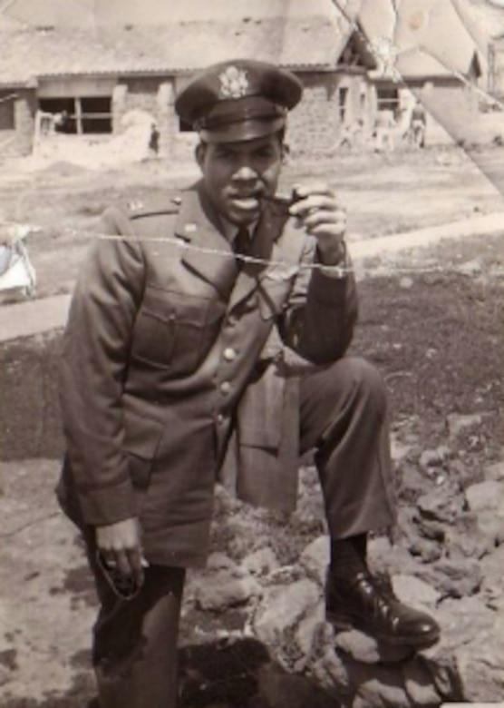 World War II pilot poses for photo